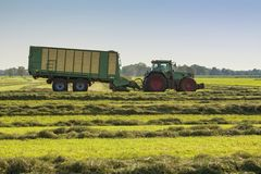 Hay racking with a tractor stock photos