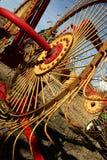 Hay Rake. Close-up of brightly painted red and yellow hay rake royalty free stock photography