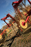 Hay Rake. Close-up of brightly painted red and yellow hay rake stock images