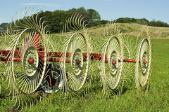 Hay rake in farmers field Royalty Free Stock Photos