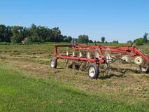 Hay Rake Sitting in a Field of Just Raked Hay Royalty Free Stock Photo