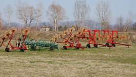 Hay Rakes. Agricultural machines - a row of hay rakes Stock Photos