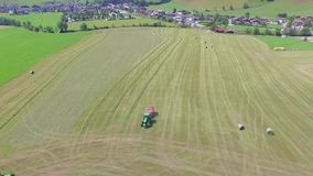 Hay Rolls In A Cropped Wheat Field., aerial view stock video