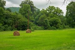 Hay Rolls in a field in the Mountains stock photos