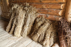 Hay sheaves in old wooden barn interior Stock Photos