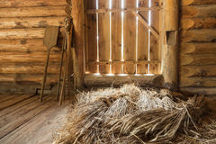 Hay sheaves in old wooden interior Stock Photo