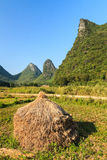 Hay stack on the land in a rocky hill landscape Royalty Free Stock Photography