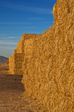 Hay Stacks. Stacks of deep golden hay piled up at the side of the road in southern Arizona near Gila Bend stock photos