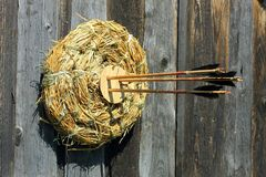 Hay target with bow arrows in it Royalty Free Stock Images