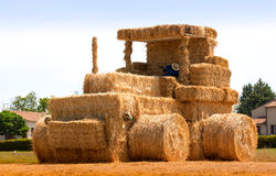 Hay tractor with sleeping man  France Royalty Free Stock Image