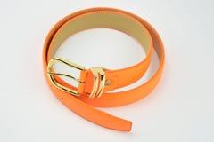 Hay una correa anaranjada del cuero artificial Imagen de archivo libre de regalías