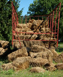 Hay wagon. Details of a hay wagon or trailer with bales of hay that appear to have fallen royalty free stock image
