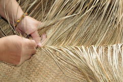 Hay weaving ( Taiwan traditional handicraft ). Royalty Free Stock Images