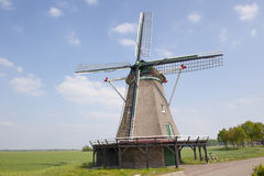 Hay wind mill in rural landscape Royalty Free Stock Photos
