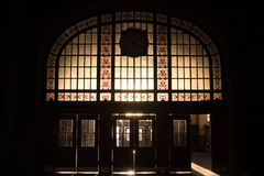 Haydarpasa train station`s main entrance into the light, the sun being filtered by art deco stained-glass Stock Image