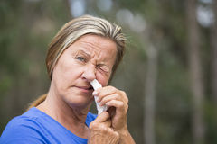 Hayfever Woman with tissue in running nose Stock Photos