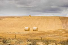 Hayfield In Autumn. With Haybales Under Cloudy Skies Royalty Free Stock Image