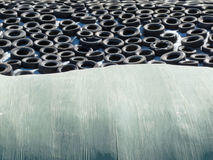 Haylage bales and covered silage under car tyres Stock Image