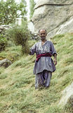 Haymaking farmer near Karimabad Royalty Free Stock Image
