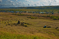A haymaking in russian village. Beautiful fall landscape Stock Photography