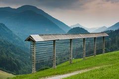 Hayrack na łące w Slovenia górach Fotografia Royalty Free