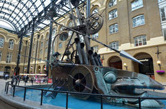 Hays Galleria in London UK. LONDON - MAY 13 2015:The Navigators sculpture in Hays Galleria. It's a popular tourist attraction complex of restaurant and shops in Stock Photos