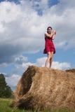 haystack девушки Стоковая Фотография