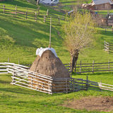 Haystack. Mountain landscape with haystack and green grass Stock Photo
