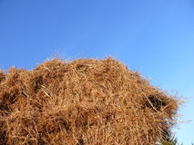 Haystack against blue sky stock photography