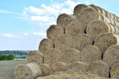 haystack against the sky with clouds stock photography