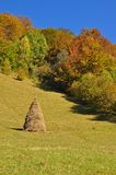 Haystack on an autumn hillside Royalty Free Stock Photo