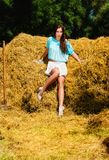 Haystack and beautiful model. Stock Image