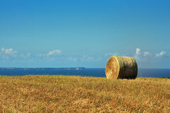 Haystack by blue sea. Scenic view of haystack with blue sea and sky background, Rugen Island, Germany Stock Photos