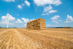 Haystack on farmfield with windmills Royalty Free Stock Photos