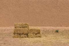 The haystack in front of dried wall made of soil and straw Stock Photography