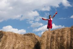 Haystack and the girl. Portrait of a girl on haystack Royalty Free Stock Images