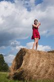 Haystack and the girl. Portrait of a girl on haystack Stock Photography