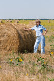 Haystack and girl. On the meadow in sunny day Royalty Free Stock Image