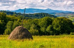 Haystack on grassy lawn on hillside. Haystack on gcountrysiderassy lawn on hillside. ecology agricultural concept. Location near Pikui mountain, Transcarpathian Royalty Free Stock Image
