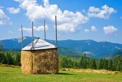 Haystack on a mountain pasture Stock Photos