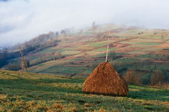 Haystack in a mountain village Royalty Free Stock Image