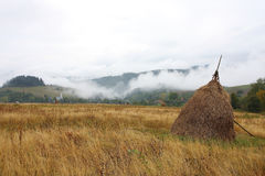 Haystack in the mountains Stock Photography