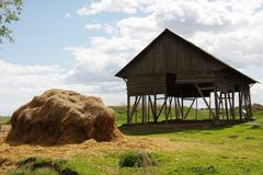 Haystack near the farm in years the day. Of blue sky Royalty Free Stock Photo
