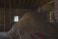 Haystack in old barn Stock Photography