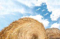 Haystack outdoors, sky with clouds in background. Stock Photo