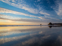 Haystack Rock beach reflection Royalty Free Stock Photography