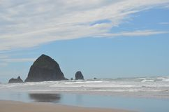 Haystack Rock at Cannon Beach, Oregon. Haystack Rock is a 235-foot sea stack in Cannon Beach, Oregon Royalty Free Stock Image