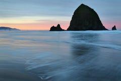 Haystack Rock, Cannon Beach, Oregon Sunrise Stock Photos