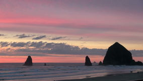 Haystack rock near shore on cannon beach. Video of haystack rock near shore on cannon beach stock video
