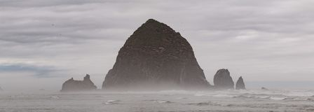 Haystack rock on the Oregon cannon beach stock photo